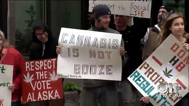 Demonstrators outside Alaska Marijuana Control Board meeting. Image via KTVA.com