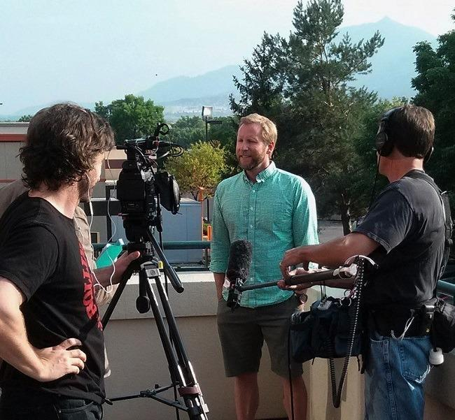 CanopyBoulder CEO and co-founder Patrick Rea being interviewed by a TV news crew. Image: WeedWorthy.com