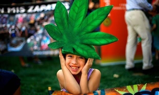 A child wearing a marijuana leaf hat poses during a rally in support of cultivation of cannabis for medicinal purposes in Santiago in March. Photograph: Ivan Alvarado/Reuters