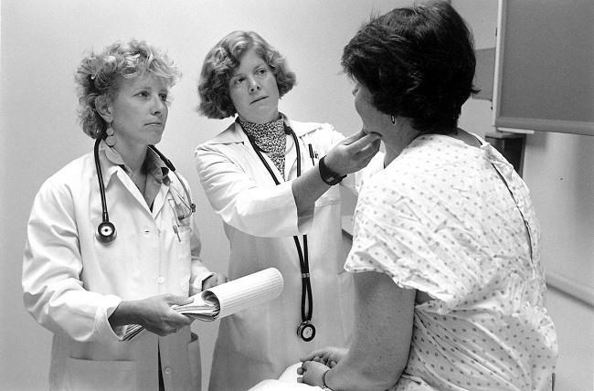 Doctors with patient. Image: Seattle Municipal Archives via Wikimedia Commons