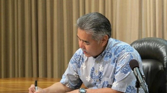Hawaii Gov. David Ige signs bills Tuesday in Honolulu, including two on medical marijuana. (Cathy Bussewitz / Associated Press)