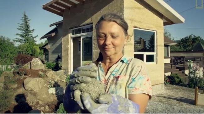 Pam Bosch, Homeowner, Highland Hemp House, with a ball of hempcrete. Video Image via National Geographic