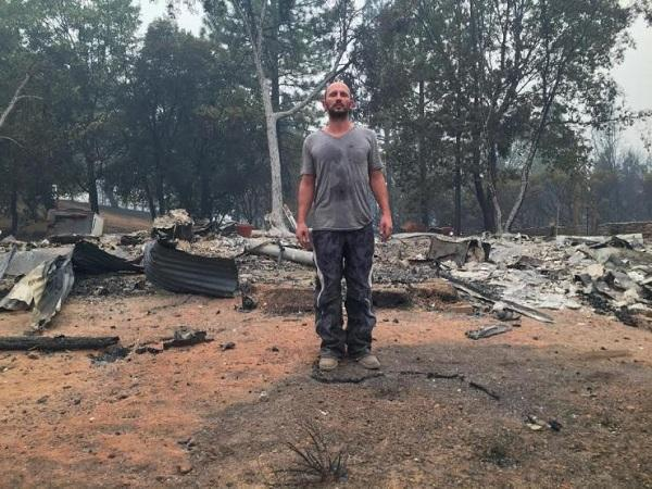 Mike Ray stands on what's left of his marijuana farm, following the Butte Fire in Calaveras County, California, in mid-September, 2015.  Image: Mike Ray via IBTimes.com