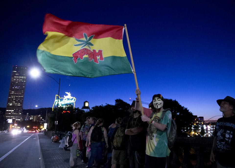 A large gathering was held at the Burnside Bridge Tuesday night as recreational marijuana became legal at midnight, July 1, 2015, in Oregon. Beth Nakamura/ Oregonian Staff