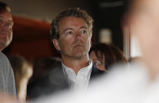 Republican presidential hopeful Sen. Rand Paul waits to speak during a campaign stop at a sports bar in Denver on Tuesday, June 30, 2015. (AP Photo/David Zalubowski)