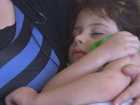 Hannah Loew, a child who suffers from a severe form of epilepsy called Dravet Syndrome, is among dozens who have moved to Colorado to receive higher concentrated doses of marijuana. Photo: KHOU