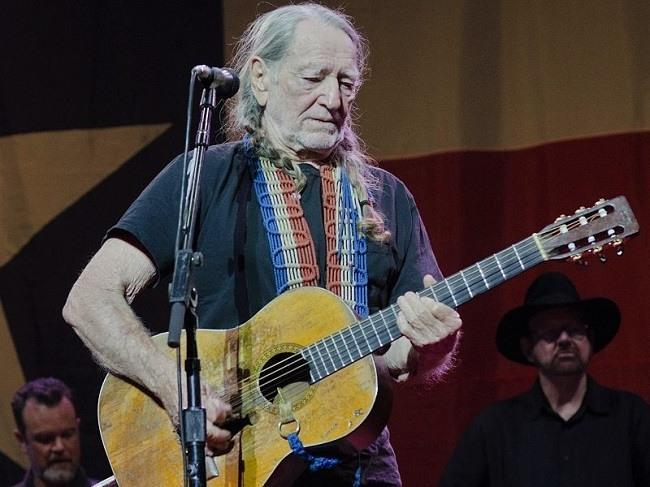 Willie Nelson performing at the Wellmont Theatre in Montclair, New Jersey, May 2012. Image: joshbg2k via Wikimedia Commons