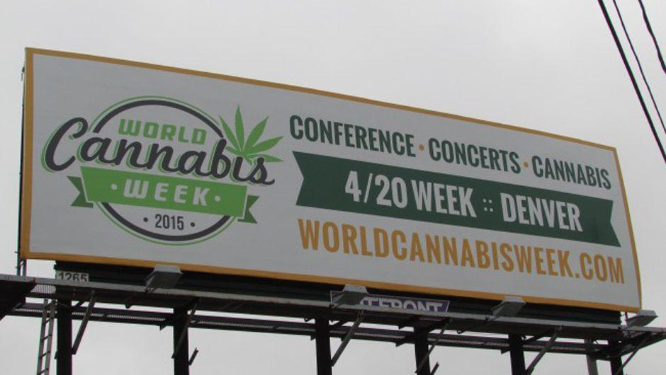 Image of a huge outdoor sign advertising World Cannabis Week in Denver - 420